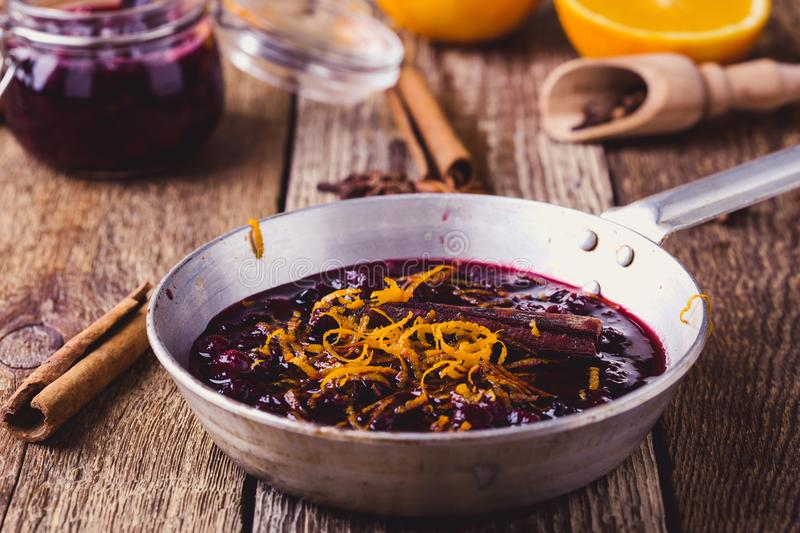 Cranberry sauce prepared in rural pan. Ready to eat, rustic style royalty free stock image
