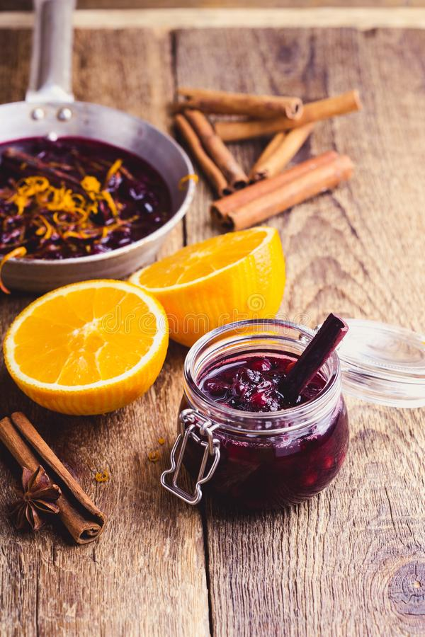 Cranberry sauce prepared in rural pan. Ready to eat, rustic style stock image