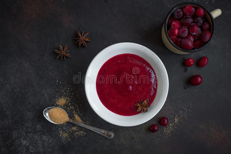 Cranberry Sauce Relish. Homemade Cranberry Sauce Relish for Thanksgiving or Christmas on wooden, close up. Traditional festive Cranberry Sauce with ingredients stock photography