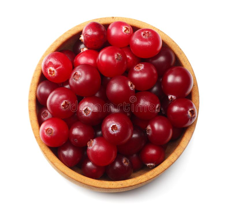 Cranberry in wooden bowl isolated on white background. top view stock photo