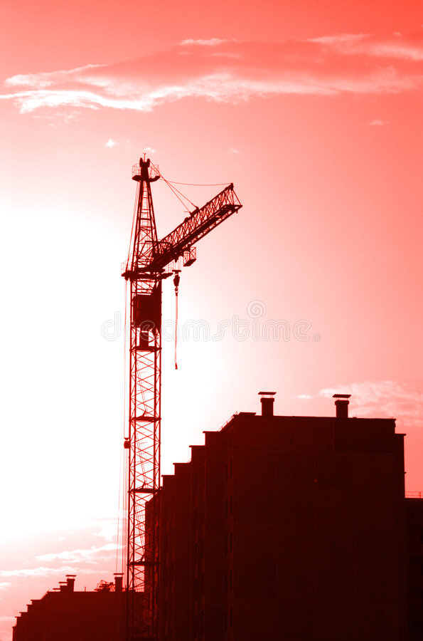 Crane. Lifting crane building the house on a construction site royalty free stock image