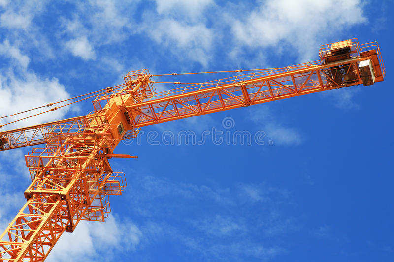 Crane and blue sky on building site stock photography