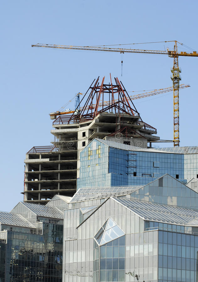 Crane and building stock photo