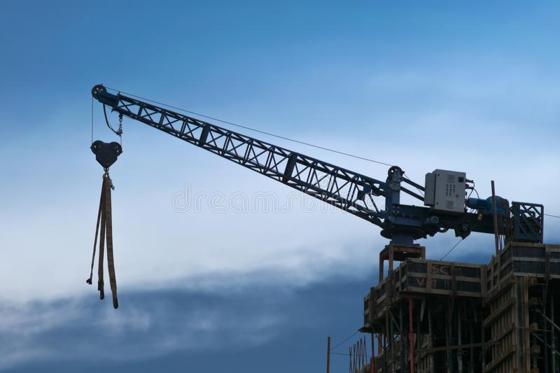 Crane in a building. Blue sky. royalty free stock photo