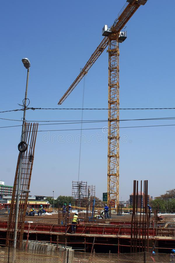 Crane in the central Business District, Johannesburg, South Africa. Workers on a tower crane in the Central Business District, Johannesburg, South Africa stock photos