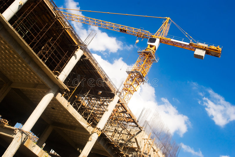 Download Crane at construction site stock image. Image of blue - 7625773