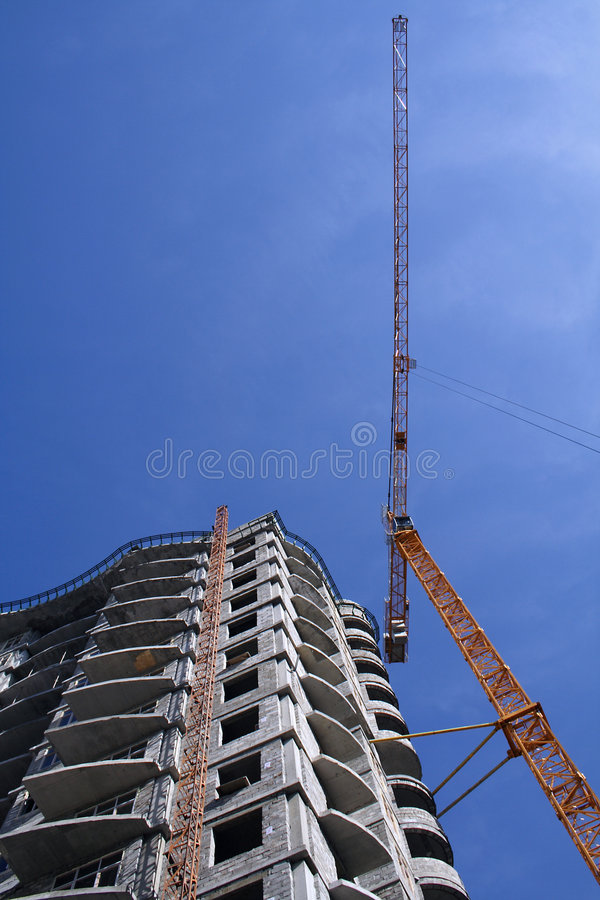 Crane on construction of building stock photography