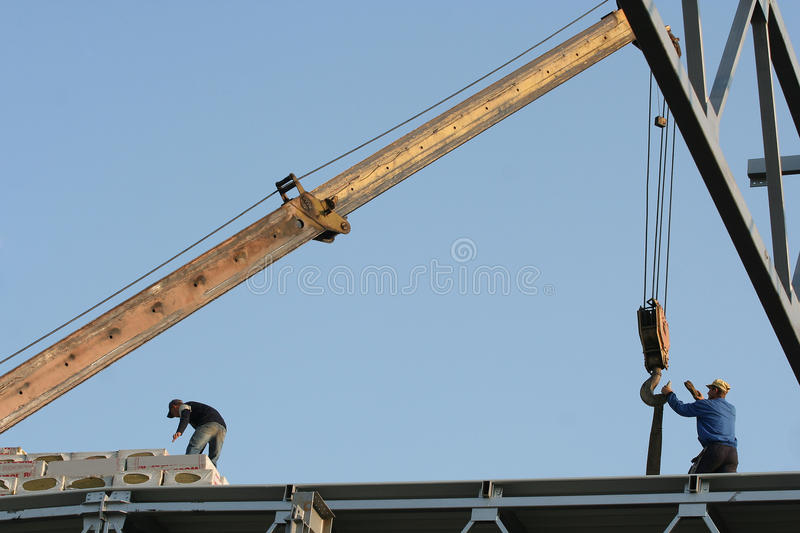 Crane on construction site royalty free stock image