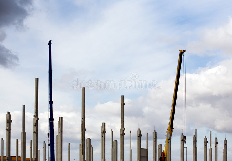 Crane at construction site royalty free stock images