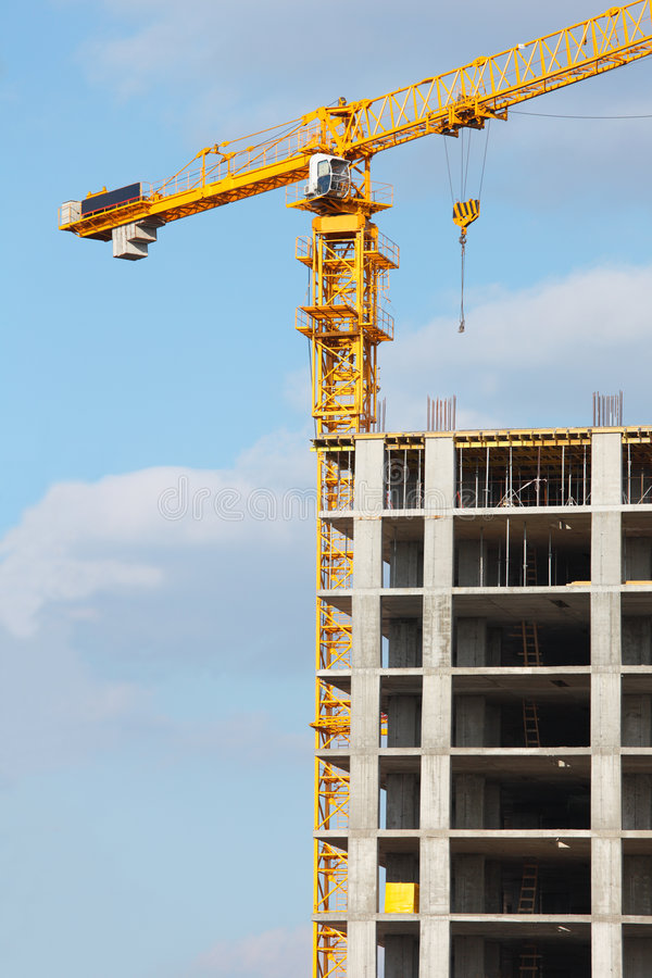 Crane on construction site royalty free stock photography