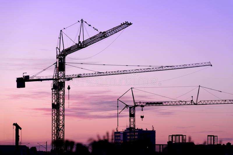 Crane on a construction site at night at night stock photos