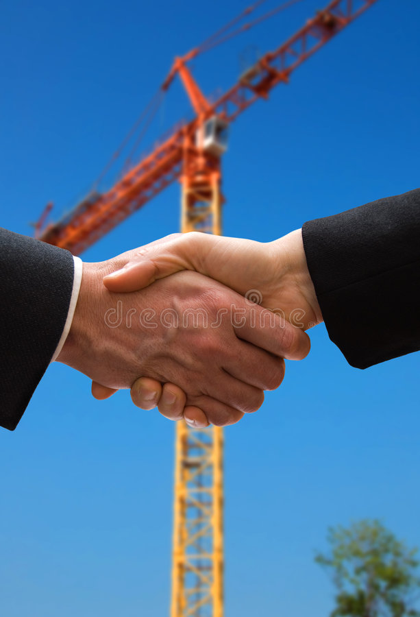 Crane deal. A hand shake to close the deal stock images