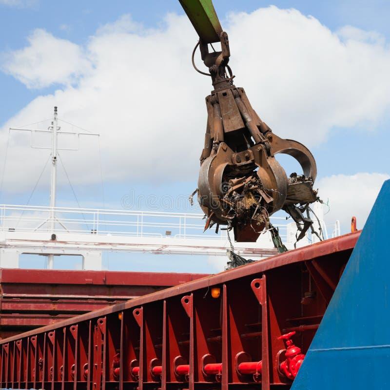 Crane grabber Loading ship with steel stock photos
