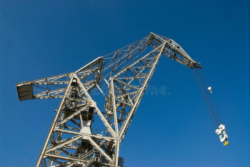 Crane in Hamburg Harbor and blue sky. Crane in Hamburg Harbor frog perspective stock photography