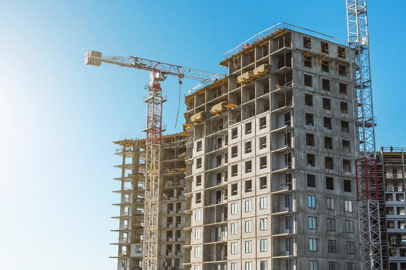 Crane and high-rise residential building. Real Estate Construction.  stock photo