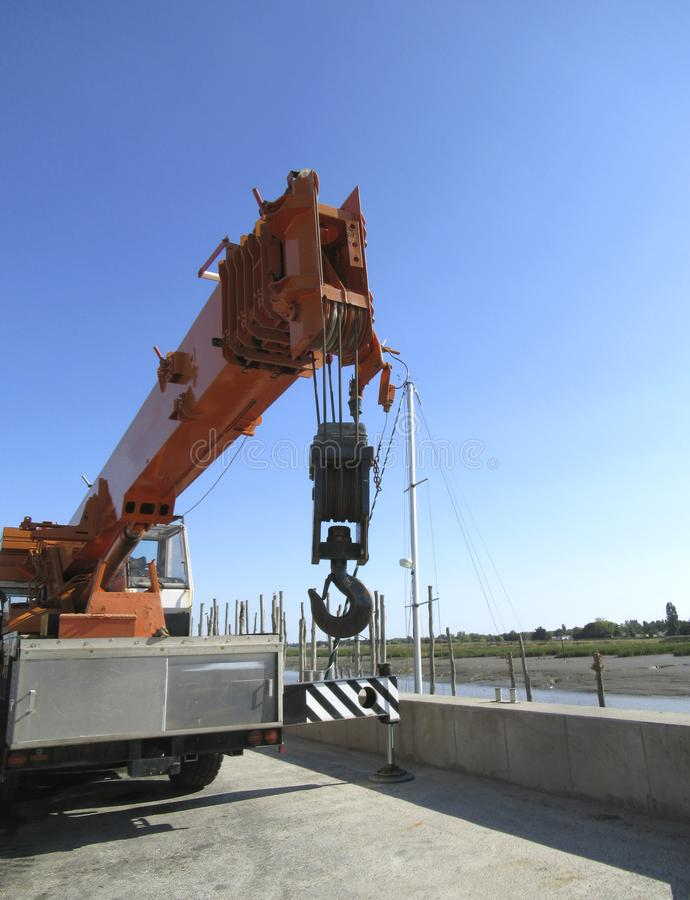 Crane hook. Compact loader. Crane hook. Equipment in the port royalty free stock photos