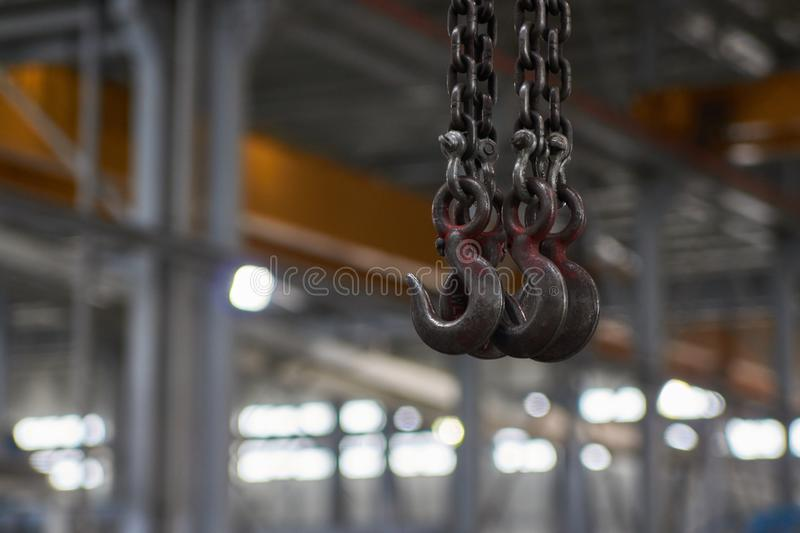 Crane hook for overhead crane in factory, close-up. royalty free stock photos