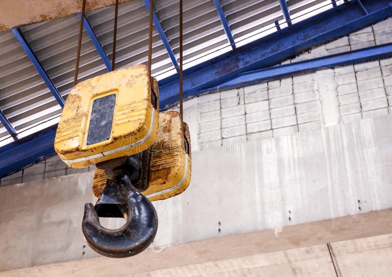 Crane hooks for lifting cranes in factories. Crane hooks for industrial lifting cranes stock photos