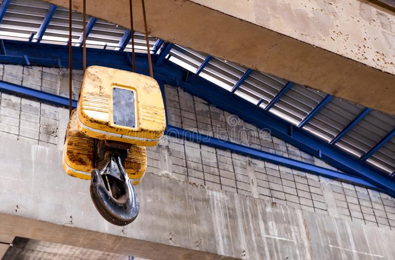 Crane hooks for lifting cranes in factories. Crane hooks for industrial lifting cranes royalty free stock photos