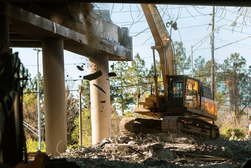 Crane Knocks Debris Off Imploded Atlanta Interstate Bridge. Atlanta, GA, USA - April 1, 2017: A crane knocks down a section of I-85 South just imploded royalty free stock images