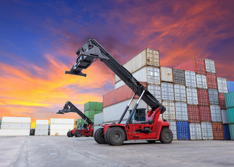 Crane lifting at container yard. With beautiful sky stock images