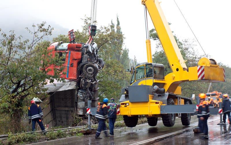 Crane lifting crashed truck royalty free stock photography