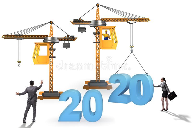Crane lifting year 2020 in business concept stock photos