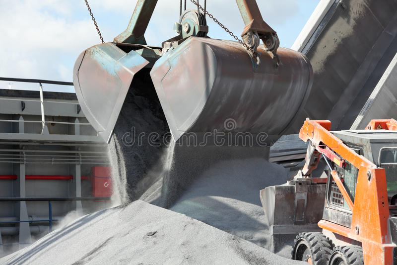 Crane Loading Cargo Ship With Gravel Stock Photos