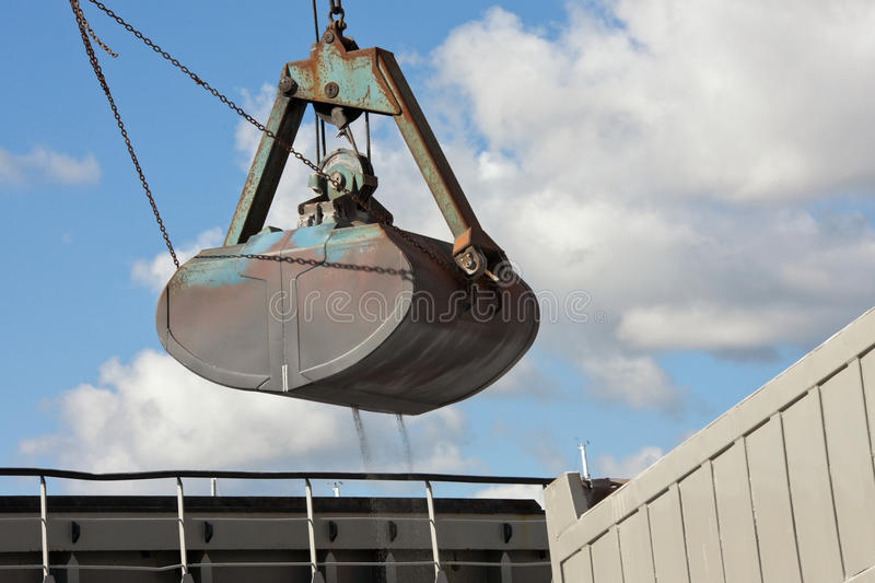 Download Crane Loading Cargo Ship With Gravel Stock Image - Image: 26783949