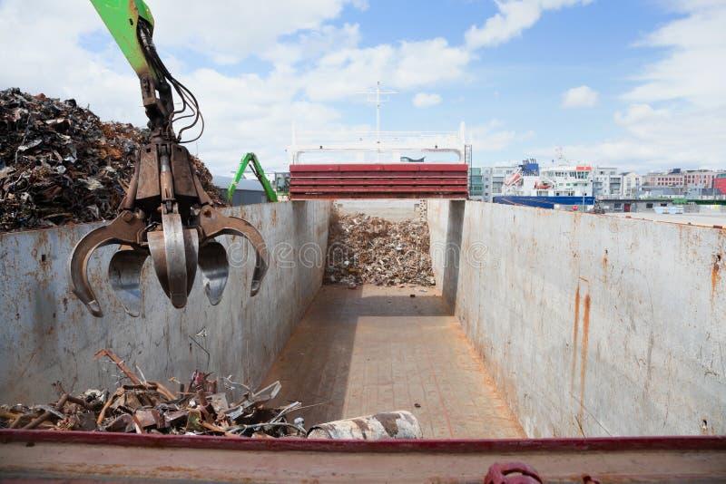 Crane Loading ship with steel stock photo