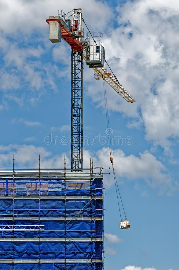Crane Loading supplies. ne150. At 47 Beane St. Gosford. November 2018. A tower crane working in high winds on new home units building site at 47 Beane St stock photography