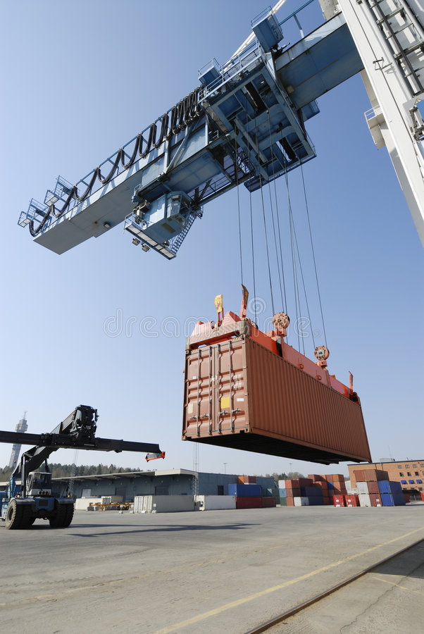 Crane Lowering Container Royalty Free Stock Photography