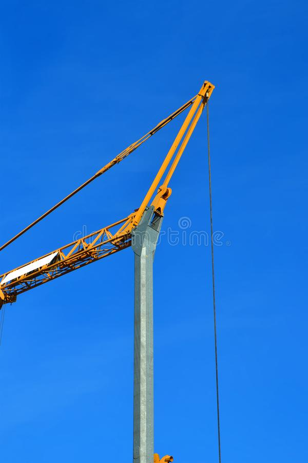 Crane metal construction on blue sky in sunny day, industry diversity,. Crane metal construction on blue sky in sunny day, modern industry diversity stock photography
