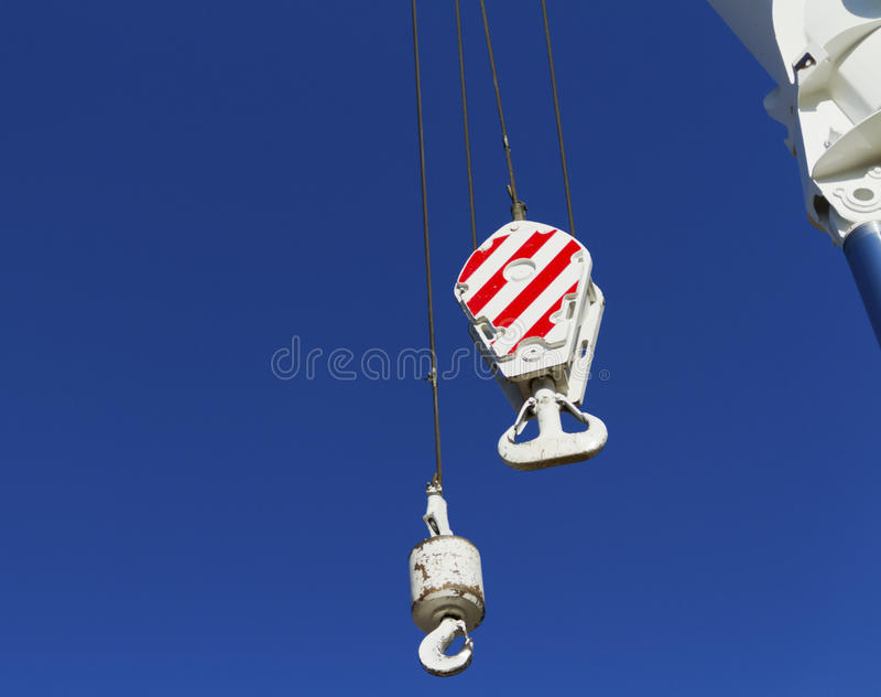 Crane monkey hook. With mast stock images