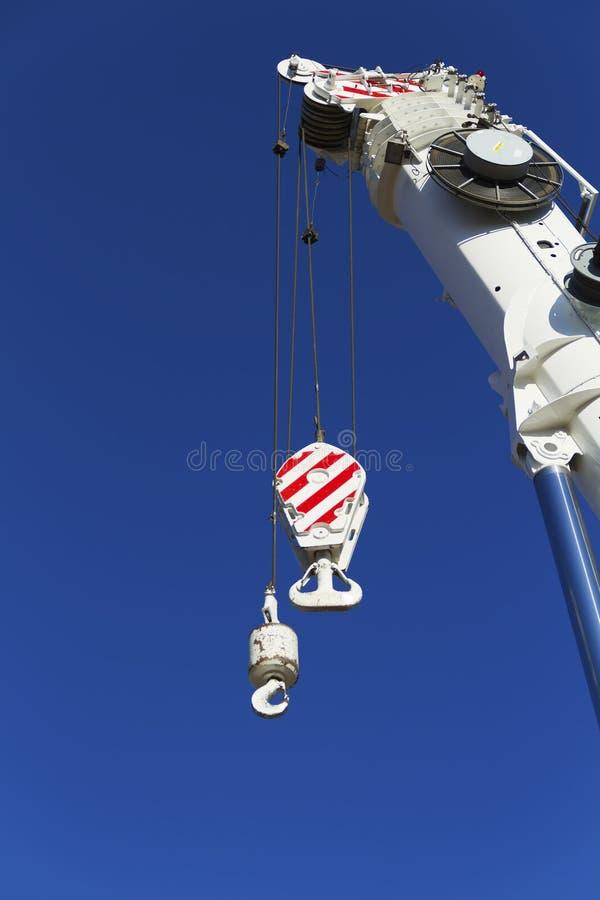 Crane monkey hook. With mast stock photography