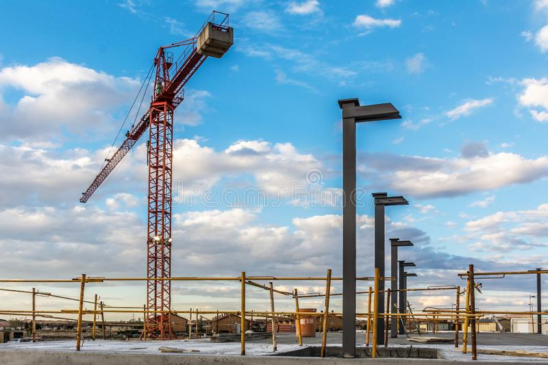 Crane at nightfall in a construction site royalty free stock photography