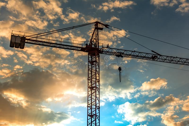 Crane at nightfall in a construction site royalty free stock images