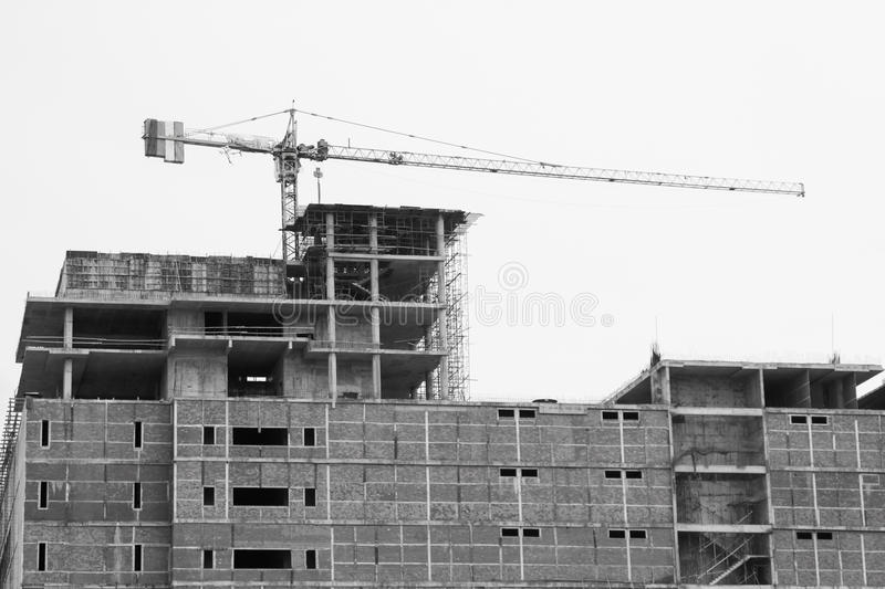 Crane operation on the building for lifting tools for installation job, Construction industry in the city and operation by crane. For heavy job royalty free stock image
