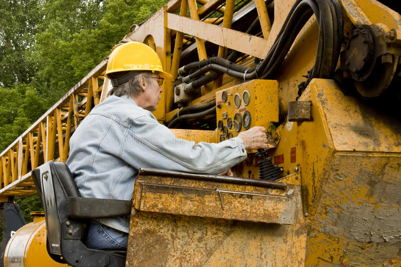 Crane operator. Construction worker at the controls of a lifting crane royalty free stock photos