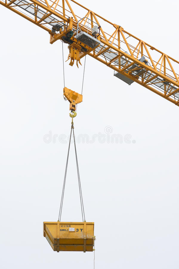 Crane. Over a cloudy day stock image