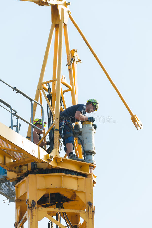 Crane removal workers stock photo