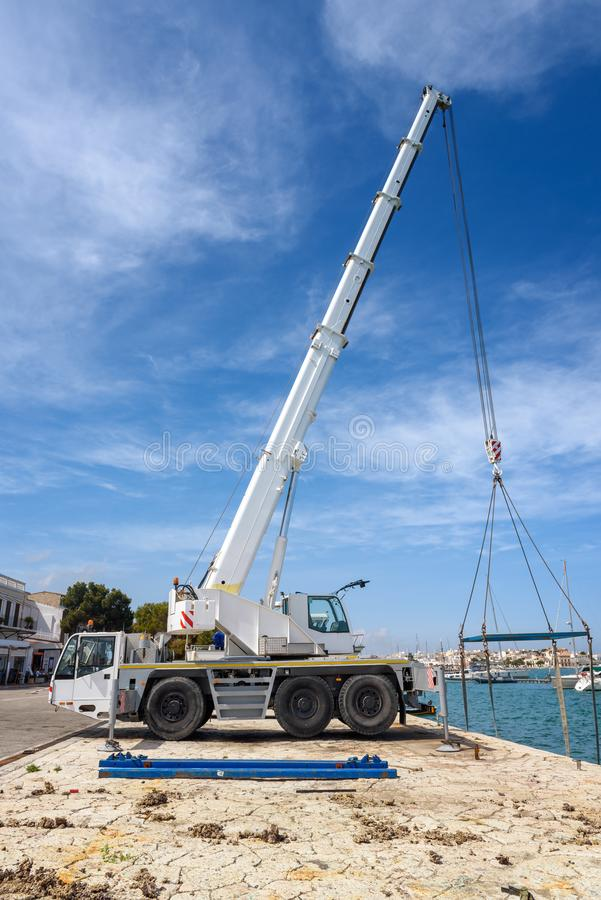 Crane services launching boats. royalty free stock photo