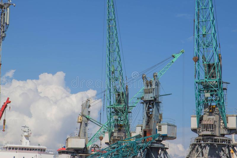 Crane ship in export and import business and logistics. Shipping cargo to harbor by crane royalty free stock images