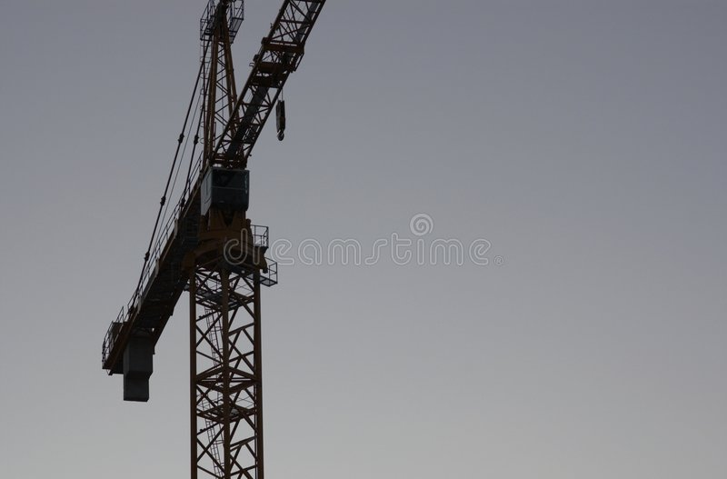 Crane silhouette. Tower crane silhouette at dusk stock photos