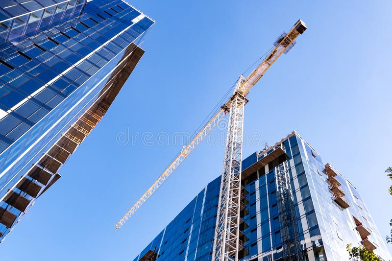 Crane and skyscrapers under construction in San Jose, South San Francisco bay area stock images