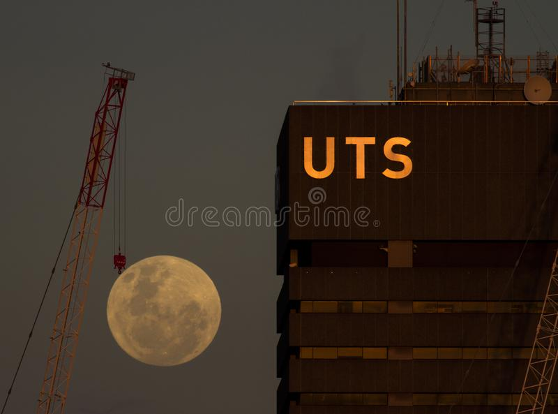 Crane a super moon besides University of Technology Sydney stock photo