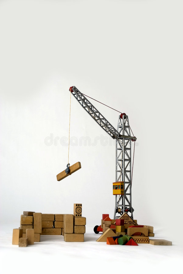 Crane to build houses. With bricks stock photos