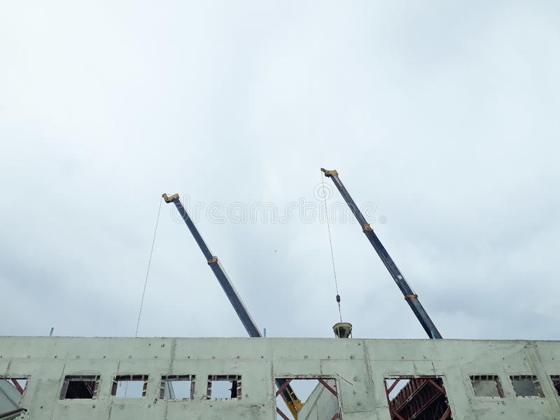 Crane, tower crane in construction site, building and cranes under construction against blue sky, they are worker construction. Building site, Tower crane at stock photography