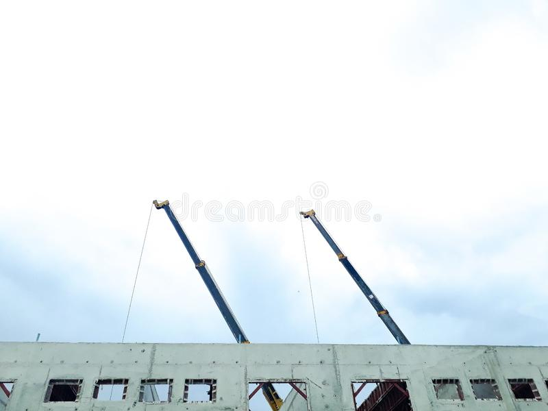 Crane, tower crane in construction site, building and cranes under construction against blue sky. They are worker construction building site, Tower crane at the stock images