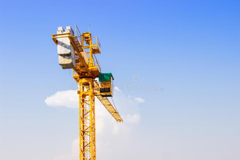 Crane is used in the construction of high buildings for tool of large industry under the blue sky and white clouds stock photos